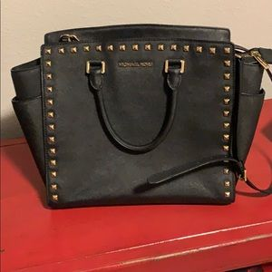 Black Michael Kors handbag and wallet